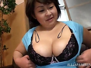 Fat Japanese woman gives titjob and sucks a dick