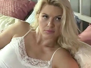 Mature bitch fucks her stepdaughter with thick strapon