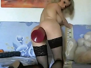 Skinny Camgirl uses a huge Butt Plug