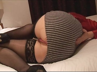 Busty Hairy mature brunette in tight mini skirt stripping