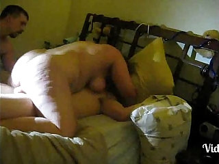 Cuckold filming wife with lover making love.