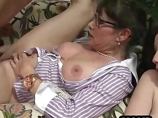 Horny threesome on the couch with a young and mature slut