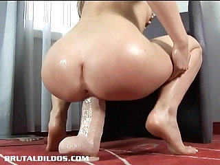 Gorgeous Lepidoptera fills her creaming pussy with giant dildos