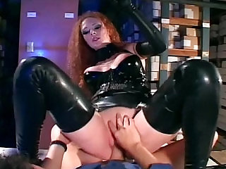Sexy redhead getting anal fucked in shiny black latex
