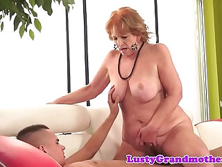 Chubby granny sucking huge cock riding it