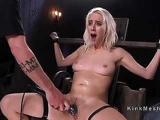 Blonde slave hard flogged and gagged with black dildo in bdsm