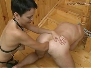 Leather girl double fists his arse then puts foot in